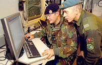 A member of 14 Geographical Squadron, Royal Engineers instructing a member of the Danish Army to use current mapping software, during Exercise ARRCADE Fusion 04