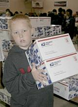 OpGrat boy with boxes