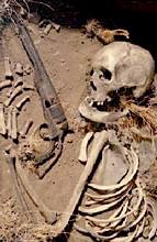 Skeleton with gun, from a ghost town in Wyoming