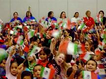 Children wave Mexican flags
